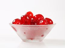 Red Glace Cherries. Stoned maraschino cherries candied in sugar syrup Royalty Free Stock Photography