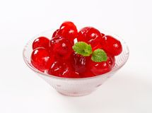 Red Glace Cherries. Stoned maraschino cherries candied in sugar syrup Stock Photos