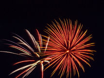 Red Glare. 2 Firework shells light up the sky in a starburst fashion Royalty Free Stock Photography