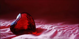 Red glas heart diamond with pink background Royalty Free Stock Photos