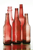 Red Glass. Background with creative bottles.red bottle Stock Photo