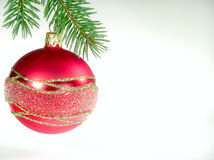 Red glass ball. On Christmas tree Royalty Free Stock Images