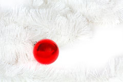 Red glass ball and Christmas tinsel Royalty Free Stock Photo