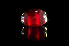 Red glass bead with reflection Royalty Free Stock Photography