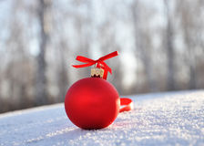 Red glass christmas balls on background snow Royalty Free Stock Photography
