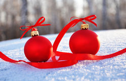 Red glass christmas balls on background snow Royalty Free Stock Photos