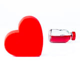 Red Glass Flask and the Heart in Front Royalty Free Stock Photos