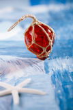 Red Glass float with white starfish Royalty Free Stock Photos