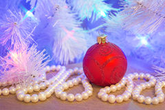 Red glass glitter Christmas bauble with natural pearl garland Stock Photo