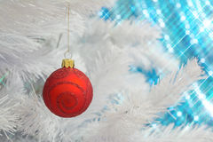 Red glass glitter ornament Christmas bauble hanging on a white Christmas tree Royalty Free Stock Photography