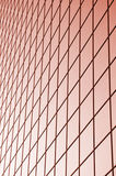Red glass grid. A photo of huge light red glass wall Stock Photography