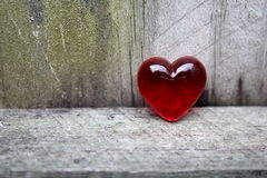Red Glass Heart on Aged Timber Royalty Free Stock Images
