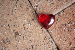 Red Glass Heart on Brick Background Royalty Free Stock Images