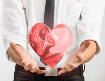 Red glass heart in businessman hands Royalty Free Stock Photos