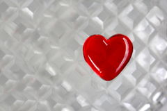 Red Glass Heart on Cut Crystal Background Royalty Free Stock Photos