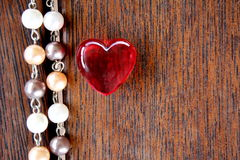 Red Glass Heart on Merbau timber with pearls Stock Photos