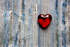 Red Glass Heart on Painted blue background Royalty Free Stock Photography