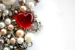 Red Glass Heart with pearls and silver chain Royalty Free Stock Photo