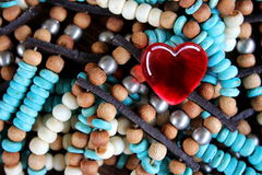 Red Glass Heart on Turquoise and Brown Beads Royalty Free Stock Images