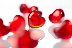 Red glass hearts. Red glass heart shape against others on white background Royalty Free Stock Image