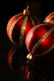 Red glass ornament on black Royalty Free Stock Photos