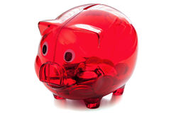 Red glass piggybank on white background stock images