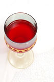 Red glass of wine. (focus in wine Royalty Free Stock Image