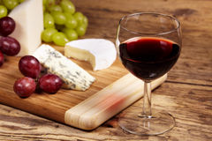 A red glass of wine. And cheese royalty free stock photography