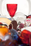 Red glass wine cup and a mass of kitchen utensils Stock Photography
