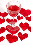 Red glass of wine and red hearts. In white Stock Photo