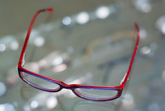 Red glasses Stock Images