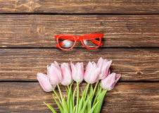 Red glasses and bouquet of tulips Stock Photo