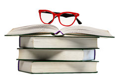 Red glasses on open book Stock Image