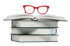 Red glasses on open book Stock Photo