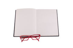 Red glasses placed on notebook, the picture with the place for your text. Red glasses placed on notebook, isolated on white background - the picture with the stock images