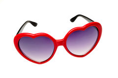 Red glasses in the shape of a heart Royalty Free Stock Image
