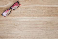 Red glasses on wood table.  stock photos