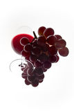 Red glasswine and grapes seen from below. Glass of red wine and grapes. Shot from below Stock Photos
