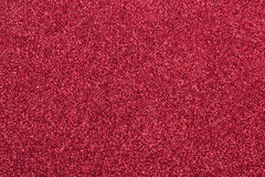 Red glitter background. Bright glamorous red background with fine glitter royalty free stock images