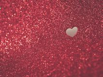 Red glitter Valentines Day background. Red glitter background with cutout heart shape stock images