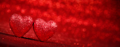 Red glitter background with hearts Royalty Free Stock Photography