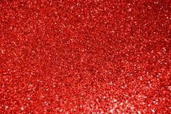 Red  Glitter background. Holiday, Christmas, Valentines, Beauty and Nails abstract texture Royalty Free Stock Photos