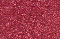A red glitter background. Wallpaper made of sparkling red glitter Royalty Free Stock Photography