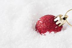 Red Glitter Bauble in Snow Stock Photos