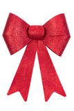 Red glitter Christmas bow. Red decorative glittery Christmas bow isolated on a white background Royalty Free Stock Images