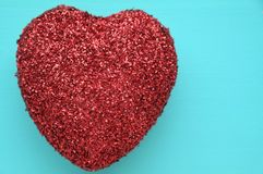 A red glitter heart. On a blue background Stock Photos