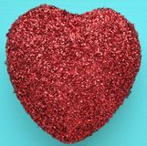 A red glitter heart. A red heart on a blue background Stock Photo