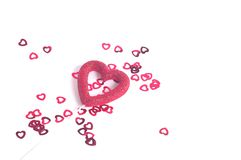 Red Glitter Heart and sprinkles. Sprinkled red hearts Stock Images