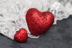 Red Glitter Hearts over White Lase . Black Background. Valentine& x27;s Day Concept. Red Glitter Hearts over White Lase . Black Background. Valentine& x27;s Day Royalty Free Stock Images