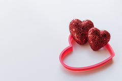 Red Glitter Hearts on a Textured White Background Royalty Free Stock Photography